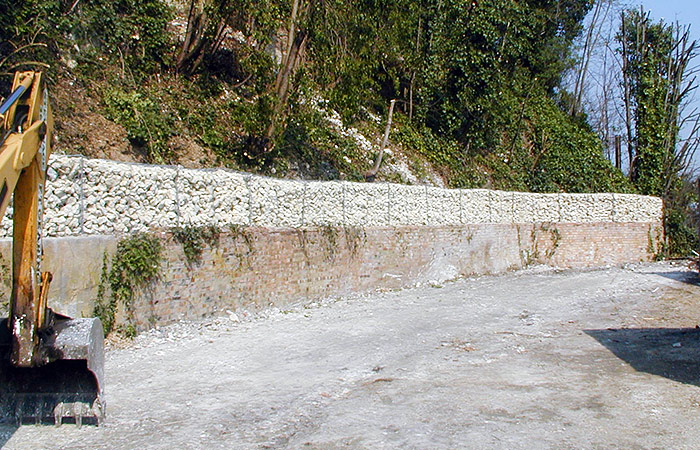 A retaining wall installed to protect car park from falling debris